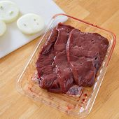 Raw liver still in its grocery store packaging.