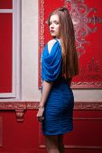 Sensual Girl In Blue Evening Dress In Red Vintage Interior