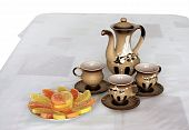 Coffee Pot , Three Coffee Cups And Candied  Citruses