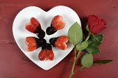 Happy Valentines Day Chocolate Dipped Heart Shaped Strawberries On Heart Shape White Plate With Red