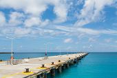 Concrete Pier Into Blue Ocean