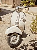 stock photo of vespa  - Vintage Italian scooter the famous vespa used for the wedding day - JPG