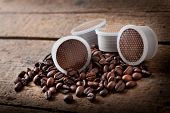 image of bean-pod  - Coffee beans with pods on wooden table - JPG