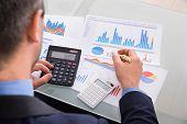 Businessman Calculating Finance