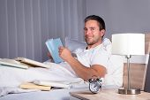 Man Enjoying Reading Book