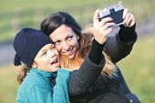 woman and child shooting a selfie