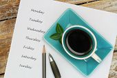 Coffee and weekdays listed on white piece of paper