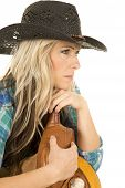 Cowgirl Blue Shirt Black Hat Lean On Saddle Look Side