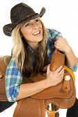 Cowgirl Blue Shirt Black Hat Lean On Saddle Smiel Looking Up