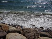 picture of martha  - Waves crash into a rocky beach on the coast of Martha - JPG