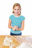 Happy Girl Kneads Dough For Pie On Kitchen Table Isolated