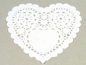 A white paper lace doily