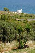 Small white church on the Aegean coast