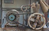 image of air pressure gauge  - Rusty air compressor (belt drive), part of air compressor. ** Note: Shallow depth of field - JPG
