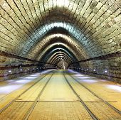 stock photo of tram  - Tunnel with a railroad and a tram - JPG