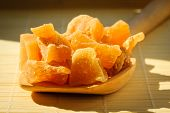 stock photo of home remedy  - Closeup candied crystallized ginger candy pieces on wooden spoon - JPG