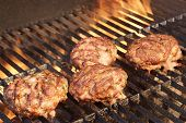 stock photo of bbq party  - Minced Beef Pork Mutton Burgers On The Hot BBQ Grill Background Closeup - JPG