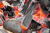 foto of charcoal  - Glowing Hot Charcoal In Fireplace Background Texture Close - JPG