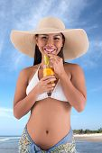 picture of filipina  - Attractive Filipina woman enjoying fresh cocktail on the seaside - JPG