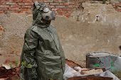 pic of gas mask  - Man with gas mask and green military clothes explores dead bird after chemical disaster - JPG