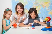 image of earth mars jupiter saturn uranus  - Kids making a scale model of the solar system in science class  - JPG