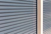 foto of roller shutter door  - steel roller shutter door weathered - JPG