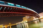 pic of calatrava  - The Constitution Bridge Venice at night vertical It is the fourth bridge over the Grand Canal and was designed by Calatrava and was moved into place in 2007 - JPG