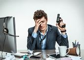 picture of suicide  - Young businessman with gun wants to commit suicide  - JPG