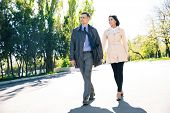 picture of girl walking away  - Full length portrait of a smiling couple walking outdoors - JPG