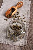 pic of peppercorns  - Green peppercorns in a glass jar on burlap - JPG
