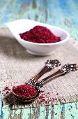 pic of fenugreek  - Ground sumac in a metal spoon on a wooden surface - JPG