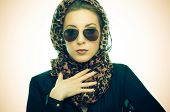 foto of leopard  - Young woman with leopard pattern scarf and sunglasses - JPG