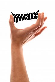 picture of ignore  - Color vertical shot of a hand squeezing the word  - JPG