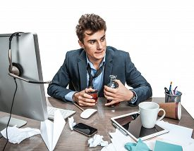 foto of alcoholic drinks  - Young alcoholic business man drinking whiskey sitting drunk at office with computer holding glass looking depressed wearing loose tie in alcohol addiction problem conceptYoung alcoholic business man drinking whiskey sitting drunk at office with computer h - JPG