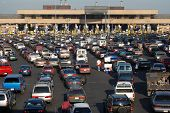 picture of smuggling  - cars lined up to pass into america from tijuana mexico - JPG