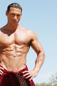 Muscular man with red towel
