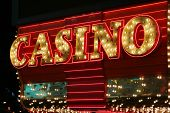 stock photo of keno  - Bright neon casino sign - JPG