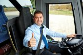 transport, tourism, road trip and people concept - happy driver driving intercity bus and snowing th poster