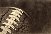 stock photo of dimples  - A rustic, retro american football background with a grunge, worn texture