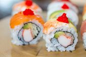 Постер, плакат: Sushi Set Sushi Roll With Salmon And Sushi Roll With Avocado