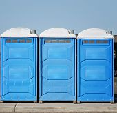 stock photo of porta-potties  - Portable toilet bathrooms on construction and event site - JPG