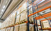 logistic, storage, shipment, industry and manufacturing concept - cargo boxes storing at warehouse s poster