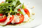 Постер, плакат: Caprese Salad Salad with Tomatoes Mozzarella Cheese and Rocket Salad Salad Dressing with Pesto S