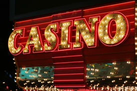 picture of poker machine  - Bright neon casino sign - JPG