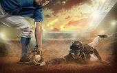 Baseball players in dynamic action on the stadium field under sunset sky. poster