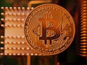 Golden bitcoin BTC coin on cooling hardware background, macro closeup. Blockchain investment technol poster