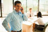 Hispanic Businessman Cell Phone Meeting