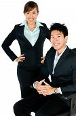 stock photo of business-partner  - A young couple in business attire on white background - JPG