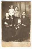 stock photo of debonair  - Old photo of family - JPG