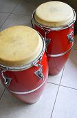 image of congas  - Caribbean style conga drums with light reflection - JPG
